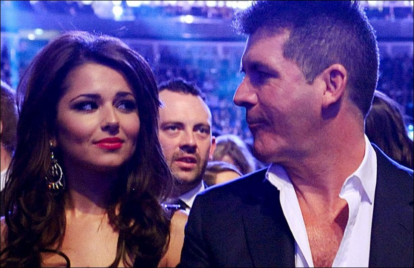 IKKE VENNER MER: Cheryl Cole og Simon Cowell p&aring; et bilde fra i fjor - f&oslash;r vennskapet surnet. Foto: PA